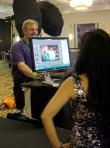 William Morton shows previews prior to printing event portraits