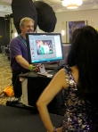 William Morton shows previews prior to printing event portraits